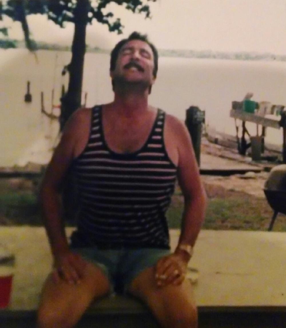 Dad leaning back at Lake Seminole House  Crop